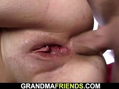Busty old lady getting mouth and ass fucked